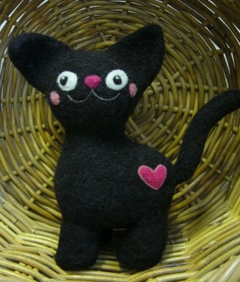 Mustan kissan paksut posket/Milla Karppinen